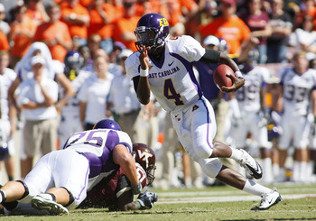 BLACKSBURG, VA - SEPTEMBER 18:  Quarterback Dominique Davis #4 of the East Carolina Pirates runs with the ball against the Virginia Tech Hokies at Lane Stadium on September 18, 2010 in Blacksburg, Virginia.  (Photo by Geoff Burke/Getty Images)