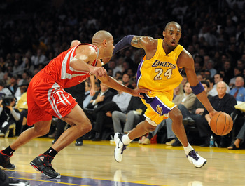 LOS ANGELES, CA - JANUARY 05:  Kobe Bryant #24 of the Los Angeles Lakers dribbles around Shane Battier #31 of the Houston Rockets during the first half at Staples Center on January 5, 2010 in Los Angeles, California.  NOTE TO USER: User expressly acknowle