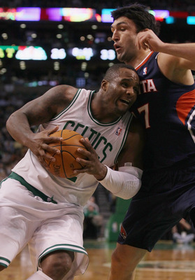 BOSTON, MA - DECEMBER 16:  Glen Davis #11 of the Boston Celtics drives to the net as Zaza Pachulia #27  of the Atlanta Hawks defends on December 16, 2010 at the TD Garden in Boston, Massachusetts. NOTE TO USER: User expressly acknowledges and agrees that,