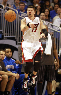 ORLANDO, FL - FEBRUARY 03:  Forward Mike Miller #13 of the Miami Heat passes against the Orlando Magic at Amway Arena on February 3, 2011 in Orlando, Florida. NOTE TO USER: User expressly acknowledges and agrees that, by downloading and or using this phot