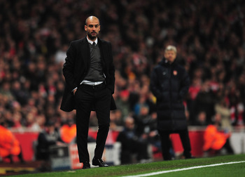 LONDON, ENGLAND - FEBRUARY 16:  Josep Guardiola, Coach of Barcelona watches with Arsene Wenger, Manager of Arsenal during the UEFA Champions League round of 16 first leg match between Arsenal and Barcelona at the Emirates Stadium on February 16, 2011 in L