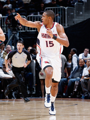 ATLANTA, GA - DECEMBER 11:  Al Horford #15 of the Atlanta Hawks against the Indiana Pacers at Philips Arena on December 11, 2010 in Atlanta, Georgia.  NOTE TO USER: User expressly acknowledges and agrees that, by downloading and/or using this Photograph,