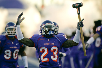 BOISE, ID - NOVEMBER 28:  Jeron Johnson #23 of the Boise State Broncos leads his team onto the field before their game against the Fresno State Bulldogs on November 28, 2008 at Bronco Stadium in Boise, Idaho.  (Photo by Otto Kitsinger III/Getty Images)