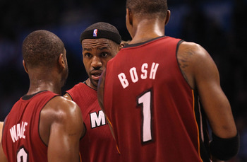 OKLAHOMA CITY, OK - JANUARY 30:  Forward LeBron James #6 talks with Dwyane Wade #3 and Chris Bosh #1 of the Miami Heat during play against the Oklahoma City Thunder at Ford Center on January 30, 2011 in Oklahoma City, Oklahoma.  NOTE TO USER: User express