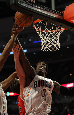 CHICAGO, IL - FEBRUARY 15: Gerald Wallace #3 of the Charlotte Bobcats tries for a rebound against the Chicago Bulls at the United Center on February 15, 2011 in Chicago, Illinois. The Bulls defeated the Bobcats 106-94. NOTE TO USER: User expressly acknowl