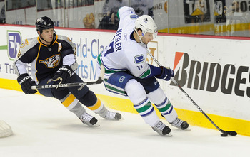 NASHVILLE, TN - FEBRUARY 17:  Ryan Kesler #17 of the Vancouver Canucks skates against Ryan Suter #20 of the Nashville Predators on February 17, 2011 at the Bridgestone Arena in Nashville, Tennessee.  (Photo by Frederick Breedon/Getty Images)