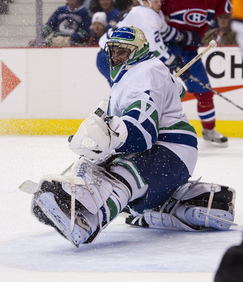 VANCOUVER, CANADA - FEBRUARY 22: Goalie Roberto Luongo #1 of the Vancouver Canucks makes a glove save against the Montreal Canadiens during the first period in NHL action on February 22, 2011 at Rogers Arena in Vancouver, British Columbia, Canada.  (Photo