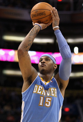 PHOENIX - NOVEMBER 15:  Carmelo Anthony #15 of the Denver Nuggets shoots a free throw shot during the NBA game against the Phoenix Suns at US Airways Center on November 15, 2010 in Phoenix, Arizona.  The Suns defeated the Nuggets 100-94.  NOTE TO USER: Us