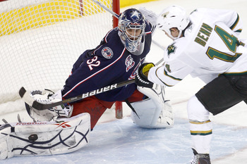 COLUMBUS, OH - DECEMBER 6:  Goaltender Mathieu Garon #32 of the Columbus Blue Jackets blocks a shot from Jamie Benn #14 of the Dallas Stars in a shootout, sealing a victory for Columbus on December 6, 2010 at Nationwide Arena in Columbus, Ohio.  Columbus