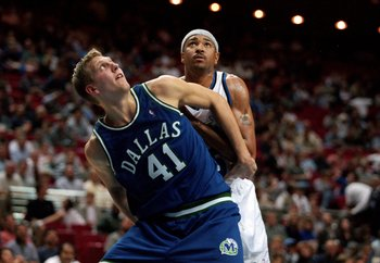25 Oct 1999:  Dirk Nowitzui #14 of the Dallas Mavericks blocks Chris Gatling #25 of the Orlando Magic during the game at the Orlando Arena in Orlando, Florida. The Magic defeated the Mavericks 109-97.     Mandatory Credit: Andy Lyons  /Allsport