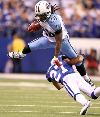 INDIANAPOLIS - JANUARY 02:  Chris Johnson #28 of the Tennessee Titans is tackled by Jacob Lacey #27 of the Indianapolis Colts at Lucas Oil Stadium on January 2, 2011 in Indianapolis, Indiana.  the Colts won 23-20.  (Photo by Andy Lyons/Getty Images)