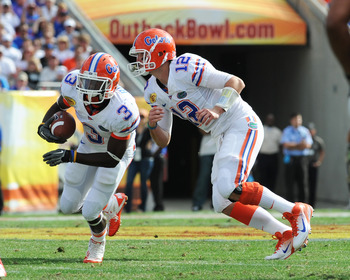 TAMPA, FL - JANUARY 1:  Quarterback John Brantley #12 of the Florida Gators hands off to running back Chris Rainey #3 against the Penn State Nittany Lions January 1, 2011 in the 25th Outback Bowl at Raymond James Stadium in Tampa, Florida.  (Photo by Al M