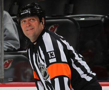 NEWARK, NJ - MARCH 17: Referee Dan O'Halloran handles the game between the Pittsburgh Penguins and the New Jersey Devils at the Prudential Center on March 17, 2010 in Newark, New Jersey.  (Photo by Bruce Bennett/Getty Images)