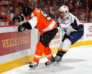 PHILADELPHIA, PA - FEBRUARY 03:  Shea Weber #6 of the Nashville Predators checks Nikolay Zherdev #93 of the Philadelphia Flyers during the second period of an NHL hockey game at the Wells Fargo Center on February 3, 2011 in Philadelphia, Pennsylvania.  (P