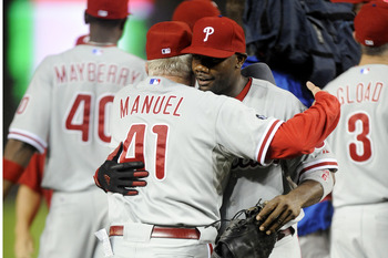 WASHINGTON - SEPTEMBER 27:  Charlie Manuel #41 and Ryan Howard #6 celebrate clinching the National League east title after a baseball game against the Washington Nationals on September 27, 2010 at Nationals Park in Washington, D.C. The Phillies won 8-0.