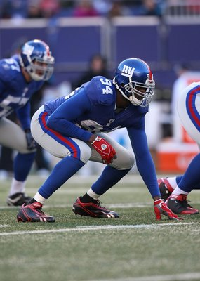 EAST RUTHERFORD, NJ - DECEMBER 27:  Mathias Kiwanuka #94 of the New York Giants against the Carolina Panthers at Giants Stadium on December 27, 2009 in East Rutherford, New Jersey.  (Photo by Nick Laham/Getty Images)