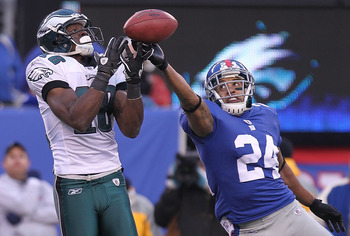 EAST RUTHERFORD, NJ - DECEMBER 19: Terrell Thomas #24  of the New York Giants breaks up the pass intended for Jeremy Maclin #18 of the Philadelphia Eagles at New Meadowlands Stadium on December 19, 2010 in East Rutherford, New Jersey.  (Photo by Nick Laha