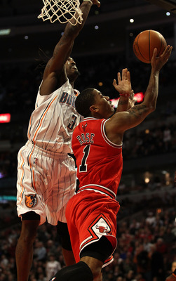 CHICAGO, IL - FEBRUARY 15: Derrick Rose #1 of the Chicago Bulls goes up for a shot against Gerald Wallace #3 of the Charlotte Bobcats at the United Center on February 15, 2011 in Chicago, Illinois. The Bulls defeated the Bobcats 106-94. NOTE TO USER: User