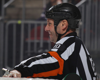 NEWARK, NJ - JANUARY 04: Referee Paul Devorski #10 works the game between the New Jersey Devils and the Minnesota Wild at the Prudential Center on January 4, 2011 in Newark, New Jersey. The Wild defeated the Devils 2-1.  (Photo by Bruce Bennett/Getty Imag