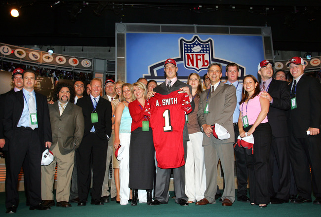 NEW YORK - APRIL 23:  Quarterback Alex Smith (C) (Utah), drafted first overall by the San Francisco 49ers, poses with his family during the 70th NFL Draft on April 23, 2005 at the Jacob K. Javits Convention Center in New York City.  (Photo by Chris Trotma