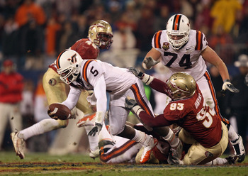 CHARLOTTE, NC - DECEMBER 04:  Everett Dawkins #93 of the Florida State Seminoles tackles Tyrod Taylor #5 of the Virginia Tech Hokies during their game at Bank of America Stadium on December 4, 2010 in Charlotte, North Carolina.  (Photo by Streeter Lecka/G