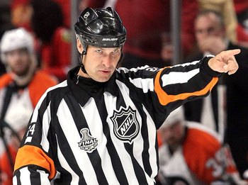 CHICAGO - MAY 31:  Referee Stephen Walkom makes a call in Game Two of the 2010 NHL Stanley Cup Final between the Chicago Blackhawks and the Philadelphia Flyers at the United Center on May 31, 2010 in Chicago, Illinois.  (Photo by Jim McIsaac/Getty Images)