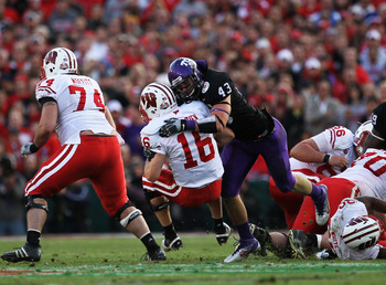 PASADENA, CA - JANUARY 01:  Quarterback Scott Tolzien #16 of the Wisconsin Badgers is sacked by linebacker Tank Carder #43 of the TCU Horned Frogs during the 97th Rose Bowl game on January 1, 2011 in Pasadena, California.  (Photo by Stephen Dunn/Getty Ima
