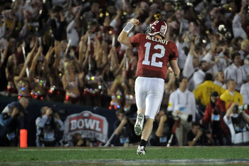 PASADENA, CA - JANUARY 07:  Quarterback Greg McElroy #12 of the Alabama Crimson Tide celebrates after a touchdown by running back Trent Richardson #3 against the Texas Longhorns in the second quarter of the Citi BCS National Championship game at the Rose