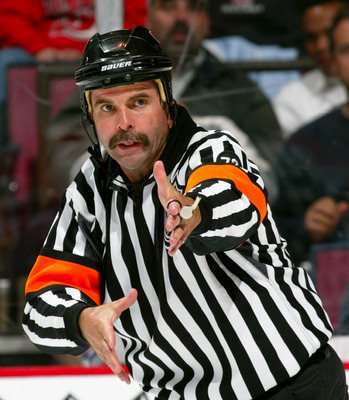 EAST RUTHERFORD, NJ - SEPTEMBER 27:  Referee Bill McCreary #7 makes a call during a preseason game between the New Jersey Devils and the New York Rangers at the Continental Airlines Arena on September 27, 2005 in East Rutherford, New Jersey.  The Devils w