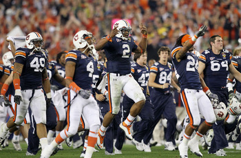 GLENDALE, AZ - JANUARY 10:  Quarterback Cameron Newton #2 of the Auburn Tigers celebrates the Tigers 22-19 victory with his team after defeating the Oregon Ducks in the Tostitos BCS National Championship Game at University of Phoenix Stadium on January 10