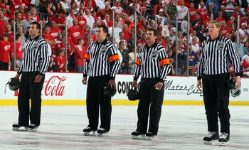 DETROIT - MAY 31:  (L-R) Linesman Steve Miller, referees Marc Joannette and Bill McCreary, and linesman Jean Morin line up for the national anthem prior to the Pittsburgh Penguins playing the Detroit Red Wings during Game Two of the 2009 Stanley Cup Final