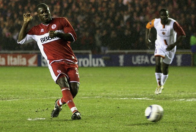 MIDDLESBROUGH, ENGLAND - MARCH 9:  Yakubu of Middlesbrough scores a goal during the UEFA Cup Round of 16 First Leg match between Middlesbrough and AS Roma at the Riverside Stadium on March 9, 2006 in Middlesbrough, England.  (Photo by Matthew Lewis/Getty
