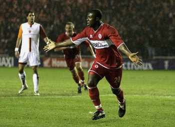MIDDLESBROUGH, ENGLAND - MARCH 9:  Yakubu of Middlesbrough celebrates his goal during the UEFA Cup Round of 16, First Leg match between Middlesbrough and AS Roma at the Riverside Stadium on March 9, 2006 in Middlesbrough, England. (Photo by Matthew Lewis/