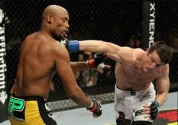 Chael Sonnen landing an overhand right on Anderson Silva