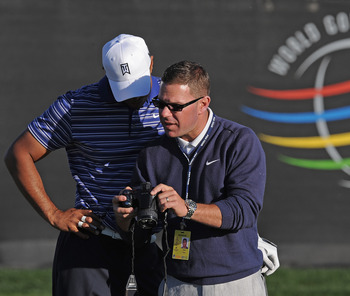 MARANA, AZ - FEBRUARY 22:  Tiger Woods  looks at a video with coach Sean Foley during practice prior to the start of the World Golf Championships-Accenture Match Play Championship held at The Ritz-Carlton Golf Club, Dove Mountain on February 22, 2011 in M