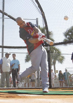 JUPITER, FL - FEBRUARY 17: Albert Pujols #5 of the St. Louis Cardinals hits the ball during batting practice at Roger Dean Stadium on February 17, 2011 in Jupiter, Florida. (Photo by Joel Auerbach/Getty Images)