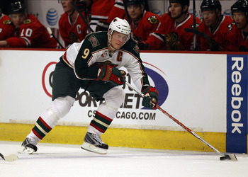 CHICAGO, IL - FEBRUARY 16: Mikko Koivu #9 of the Minnesota Wild skates up the ice against the Chicago Blackhawks at the United Center on February 16, 2011 in Chicago, Illinois. The Blackhawks defeated the Wild 3-1. (Photo by Jonathan Daniel/Getty Images)