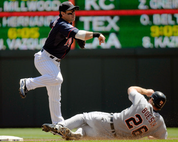 MINNEAPOLIS, MN - JUNE 30: Nick Punto #8 of the Minnesota Twins jumps out of the way of a sliding Brennan Boesch #26 of the Detroit Tigers in the second inning of their game on June 30, 2010 at Target Field in Minneapolis, Minnesota. (Photo by Hannah Fosl