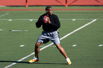SAN DIEGO, CA - FEBRUARY 10:  2010 Heisman Trophy winning quarterback Cam Newton of the Auburn Tigers goes through his workout routine for the media at Cathedral High School's sports stadium on February 10, 2011 in San Diego, California.  (Photo by Kent H