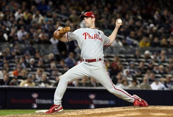 NEW YORK - OCTOBER 28:  Cliff Lee #34 of the Philadelphia Phillies throws a pitch against the New York Yankees in Game One of the 2009 MLB World Series at Yankee Stadium on October 28, 2009 in the Bronx borough of New York City. The Phillies won 6-1.  (Ph