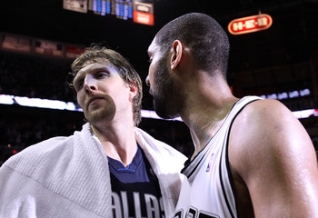 SAN ANTONIO - APRIL 29:  Forward Tim Duncan #21 of the San Antonio Spurs greets Dirk Nowitzki #41 of the Dallas Mavericks after a 97-87 win in Game Six of the Western Conference Quarterfinals during the 2010 NBA Playoffs at AT&T Center on April 29, 2010 i