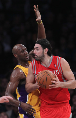 LOS ANGELES, CA - FEBRUARY 01:  Luis Scola #4 of the Houston Rockets is defended by Lamar Odom #7 of the Los Angeles Lakers in the first half at Staples Center on February 1, 2011 in Los Angeles, California. The Lakers defeated the Rockets 114-106. NOTE T
