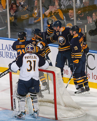 BUFFALO, NY - FEBRUARY 23: Drew Stafford #21, Jason Pominville #29, Tyler Myers and Tim Connolly #19  of the Buffalo Sabres celebrate Myers' goal in the first period against Ondrej Pavelec #31 of the Atlanta Thrashers at HSBC Arena on February 23, 2011 in