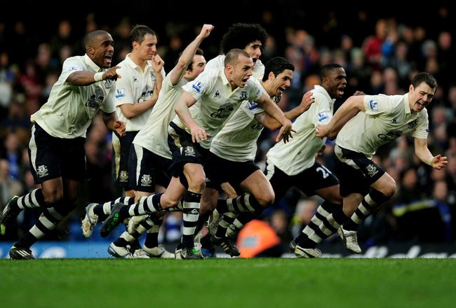LONDON, ENGLAND - FEBRUARY 19:  Everton players celebrate after their captain Phil Neville scores his penalty to win 4-3 on penalties during the FA Cup sponsored by E.ON 4th round replay match between Chelsea and Everton at Stamford Bridge on February 19,