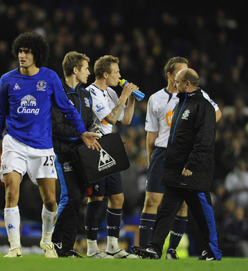 LIVERPOOL, ENGLAND - NOVEMBER 10:  Marouane Fellaini of Everton protests to referee Phil Dowd after being sent off during the Barclays Premier League match between Everton and Bolton Wanderers at Goodison Park on November 10, 2010 in Liverpool, England.