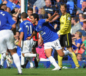 LIVERPOOL, ENGLAND - SEPTEMBER 11: Mikel Arteta of Everton celebrates scoring to make it 3-3 during the Barclays Premier League match between Everton and Manchester United at Goodison Park on September 11, 2010 in Liverpool, England.  (Photo by Michael Re