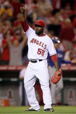 ANAHEIM, CA - JULY 01:  Relief pitcher Fernando Rodney #56 of the Los Angeles Angels of Anaheim celebrates after getting Nelson Cruz of the Texas Rangers to pop out in the eighth inning at Anaheim Stadium on July 1, 2010 in Anaheim, California. The Angels