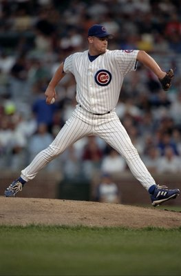 31 Aug 1998:   Pitcher Kerry Wood #34 of the Chicago Cubs swings back to  throw  during the game against the  Cincinnati  Reds  at Wrigley Field in Chicago Illinois. The Cubs defeated the Reds 5-4.