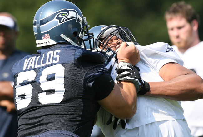 KIRKLAND, WA - JULY 25:  Defensive tackle Red Bryant #79 of the Seattle Seahawks battles Steve Vallos #69 during training camp at the team's training facility on July 25, 2008 in Kirkland, Washington. (Photo by Otto Greule Jr/Getty Images)