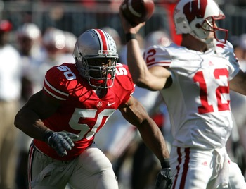 COLUMBUS, OH - NOVEMBER 03: Vernon Gholston #50 of the Ohio State Buckeyes rushes Tyler Donovan #12 of the Wisconsin Badgers on November 3, 2007 at Ohio Stadium in Columbus, Ohio. Ohio State defeated Wisconsin 38-17. (Photo by Jonathan Daniel/Getty Images